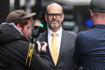 Former police commissioner Simon Overland arrives at the royal commission.