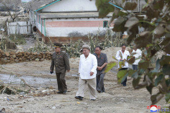 In this photo provided by the North Korean government, North Korea leader Kim Jong-un visits a typhoon-damaged area in the South Hamgyong province, North Korea.