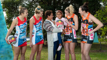 Fashion statement: Marcia Ella-Duncan and her granddaughter Gianna with Swifts Paige Hadley and Maddy Turner, left, and Giants    Jo Harten and Sam Poolman at the launch of their Indigenous round uniforms.