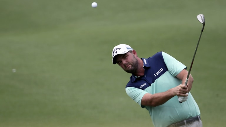 In the swing: Marc Leishman on the seventh hole during round two at the Tournament Players Club in Kuala Lumpur, Malaysia.