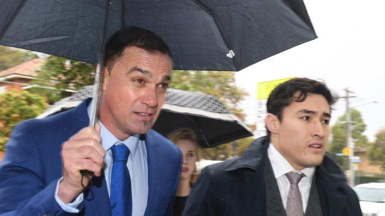 Australian musician Shannon Noll, left, arrives with his lawyer, Bryan Wrench, at Sutherland Local Court in Sydney on Thursday,