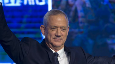 Blue and White party leader Benny Gantz salutes on Tuesday night.