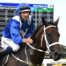 Mare is a dream: Hugh Bowman returns tot he mounting yard with Winx.
