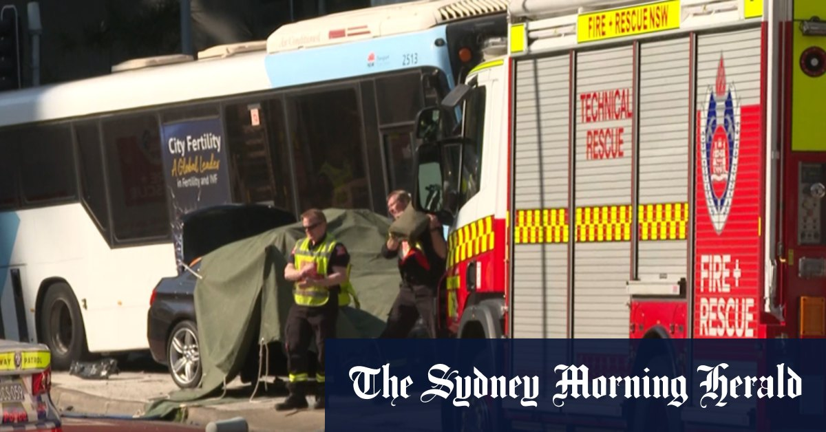 BMW driver charged after woman dies in crash between car and bus – Sydney Morning Herald