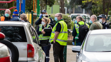 Medics are seen outside the public housing flats in Flemington as they are briefed on July 05, 2020.