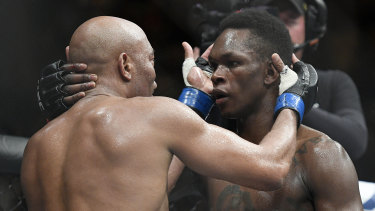 Respect: Adesanya and Silva embrace after their epic contest.