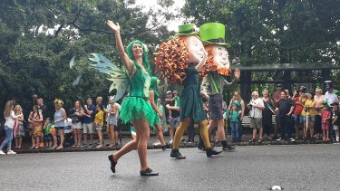 A crowd gathered outside the Botanic Gardens to watch the St Patrick's Day Parade in Queensland on March 16.
