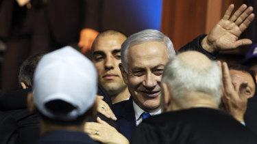 Israeli Prime Minister Benjamin Netanyahu greets attendees at the Likud party headquarters in Tel Aviv, Israel.