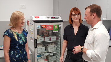 Queensland Chief Health officer Dr Jeanette Young and Health Minister Steven Miles deliver doses of the measles vaccine to theQueen Street Medical Centre in Brisbane.