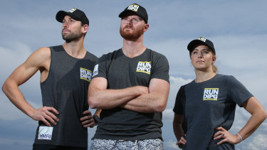 Cancer researcher Dr Matt Dun, centre, with his RUN DIPG team mates Lucas McBeath and Tabitha McLachlan. They are running to bring the world's attention to the deadly brain stem cancer, DIPG.