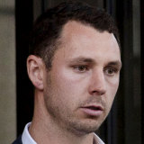 Patrick Willmott, a friend of Adam Cranston, leaving the Federal Court.