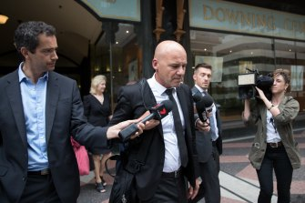 Former detective Gary Jubelin leaves Downing Centre Court on Thursday.