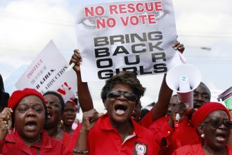 Women attend a demonstration calling on the government to rescue the kidnapped girls.