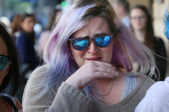 Burke's victim Erin leaves court in tears.