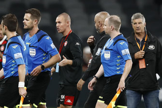 Wanderers assistant coach Kenny Miller has words with the referee after full-time.