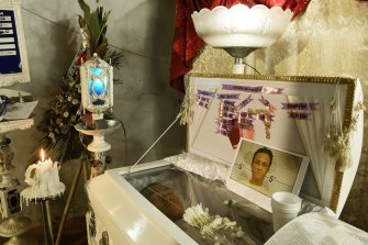 The body of Ramil Miranda,35, lies in his coffin at his wake in the Manila suburb of Malabon. The known drug user was a victim of an extra judicial killing in 2017.