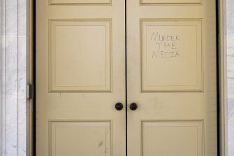 """""""Murder the Media"""" is scrawled on a door in the US Capitol building after Trump supporters rioted."""