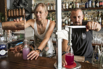Tess Robens and Fabrizio Culici from The Rio in Sydney's Summer Hill bottle cocktails for home delivery.
