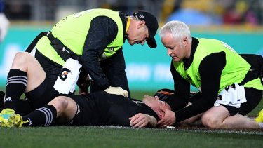 Concussion risk: Ryan Crotty receives assistance in Bledisloe I after suffering a head knock.