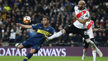 Boca's Leonarda Jara (left) and River Plate's Javier Pinola in action.