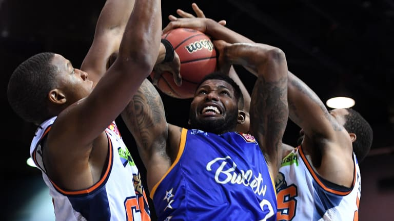 Alonzo Gee of the Bullets (centre) is blocked by Taipans defence during the round 1 NBL match between the Bullets and Cairns Taipans at the Brisbane Convention and Exhibition Centre on Saturday.