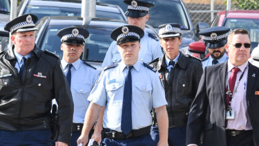 Police arrive at the inquest this week.