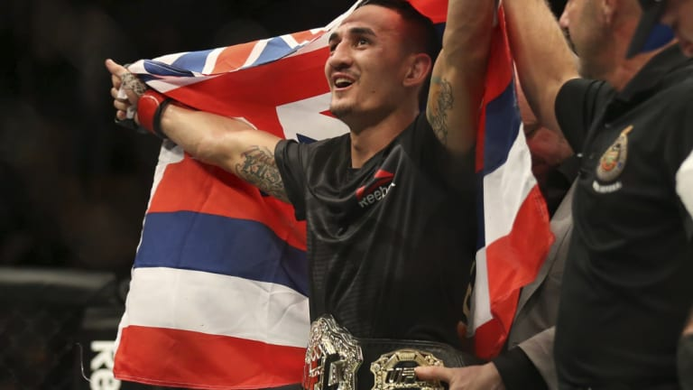 Ruled out: Max Holloway celebrates after defeating Anthony Pettis.