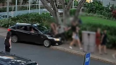 The moment a car mounts the footpath and heads towards four pedestrians in South Bank.
