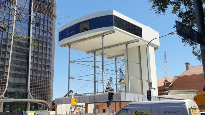 Queen's Wharf workers raise display suite seven storeys ahead of opening