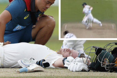 Australia's Steve Smith receives treatment as lies on the ground after being hit on the head by a ball bowled by England's Jofra Archer.