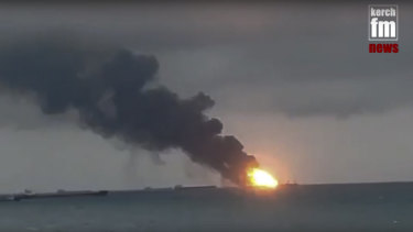 The two vessels, the Maestro and the Candiy, on fire near the Kerch Strait linking the Black Sea and the Sea of Azov, in Kerch, Crimea, on Monday.