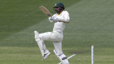 Thorn in India's side: Nathan Lyon adds to the Australian tally as they chase down an unlikely victory.