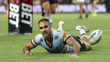 William Kennedy opens the try-scoring for the Sharks against South Sydney.