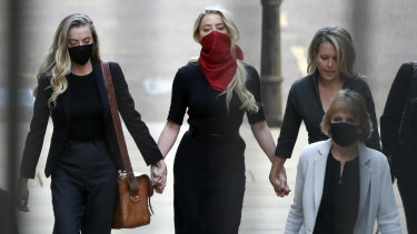 Amber Heard, centre, arrives at the High Court in London.