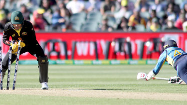 Caught short: Australian keeper Alex Carey whips off the bails to stump Sri Lanka's Waning Hasaranga.
