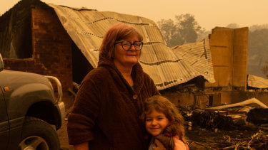 It is up to adults to give children a sense of hope: Barbara Rugendyke, pictured with one of her children in front of their property, which was devastated by bushfires.