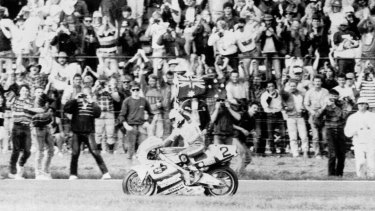 On his slowdown lap Gardner, an Australian flag flying from his bike, rode slowly around the track.  April 9, 1989.