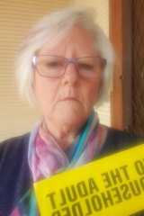 Broken Hill resident Elaine Gillett with a flyer she received from Clive Palmer.