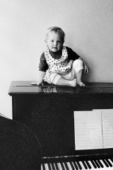 Musical family: A young Martha Marlow atop a piano.