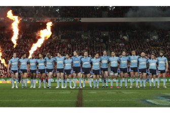 NSW players line up before kick-off in Brisbane.