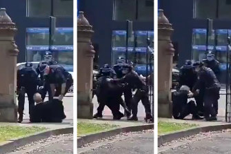 Vision of police arresting Professor Rice. He says he was grabbed from behind, and marched to a corner. He alleges his legs were kicked out from underneath him and he subsequently fell to his hands and knees.