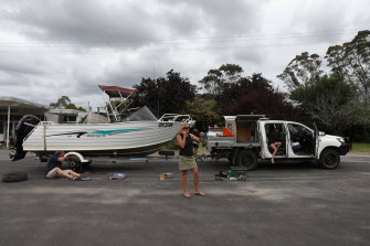 Emma and Wayne Morris broke down while crossing the border as part of the rush to get back into Victoria.