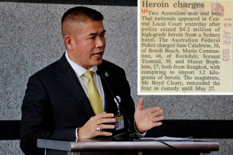 Thai minister Thammanat Prompao and the 1993 newspaper clipping about his arrest in Sydney.