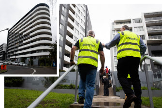 Building inspectors tour the apartment complex on Charles St Canterbury, where structural concerns have emerged this week.