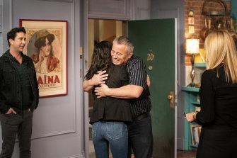 Matt LeBlanc embraces Courteney Cox during the Friends reunion.