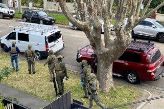Police raid a luxury apartment in Goldsmith Street, Elwood.