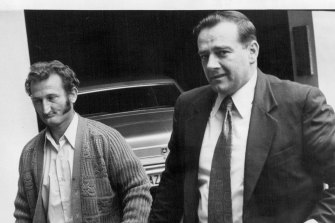 Peter Pasquale Macari (left), defendant in Qantas extortion cases escorted into central court September 29, 1971.