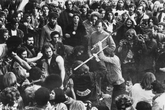 Hells Angels beat a fan with pool cues at the Altamont Free Concert, 6th December, 1969 in a still from the film Gimme Shelter.