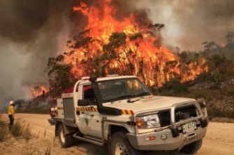 Tasmania Parks and Wildlife Service fighting a bushfire at Miena in January.