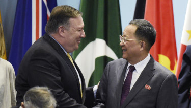US Secretary of State Mike Pompeo, left, greets North Korea's Foreign Minister Ri Yong-ho at the 25th ASEAN Regional Forum Retreat in Singapore on Saturday.